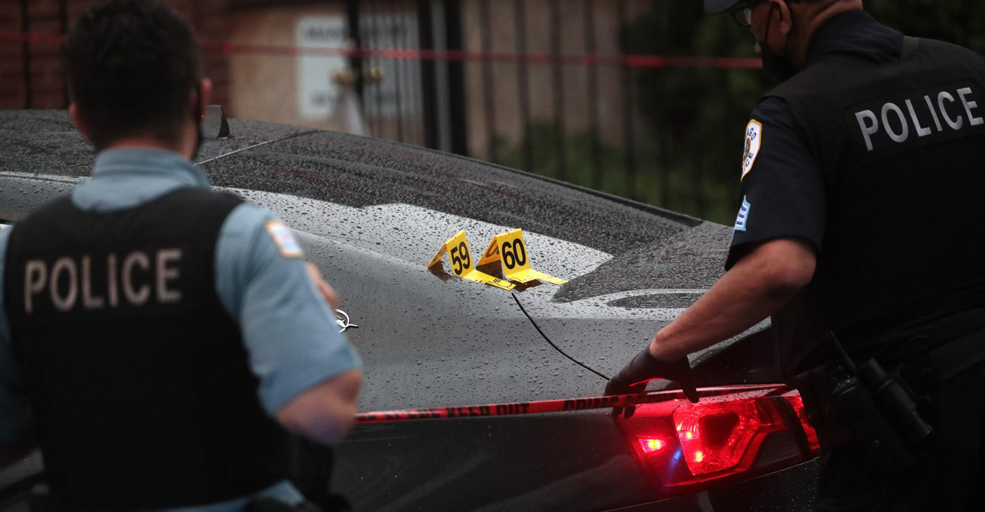A crime scene analysis in Chicago. Scott Olson/Getty Images (From Slate.com)